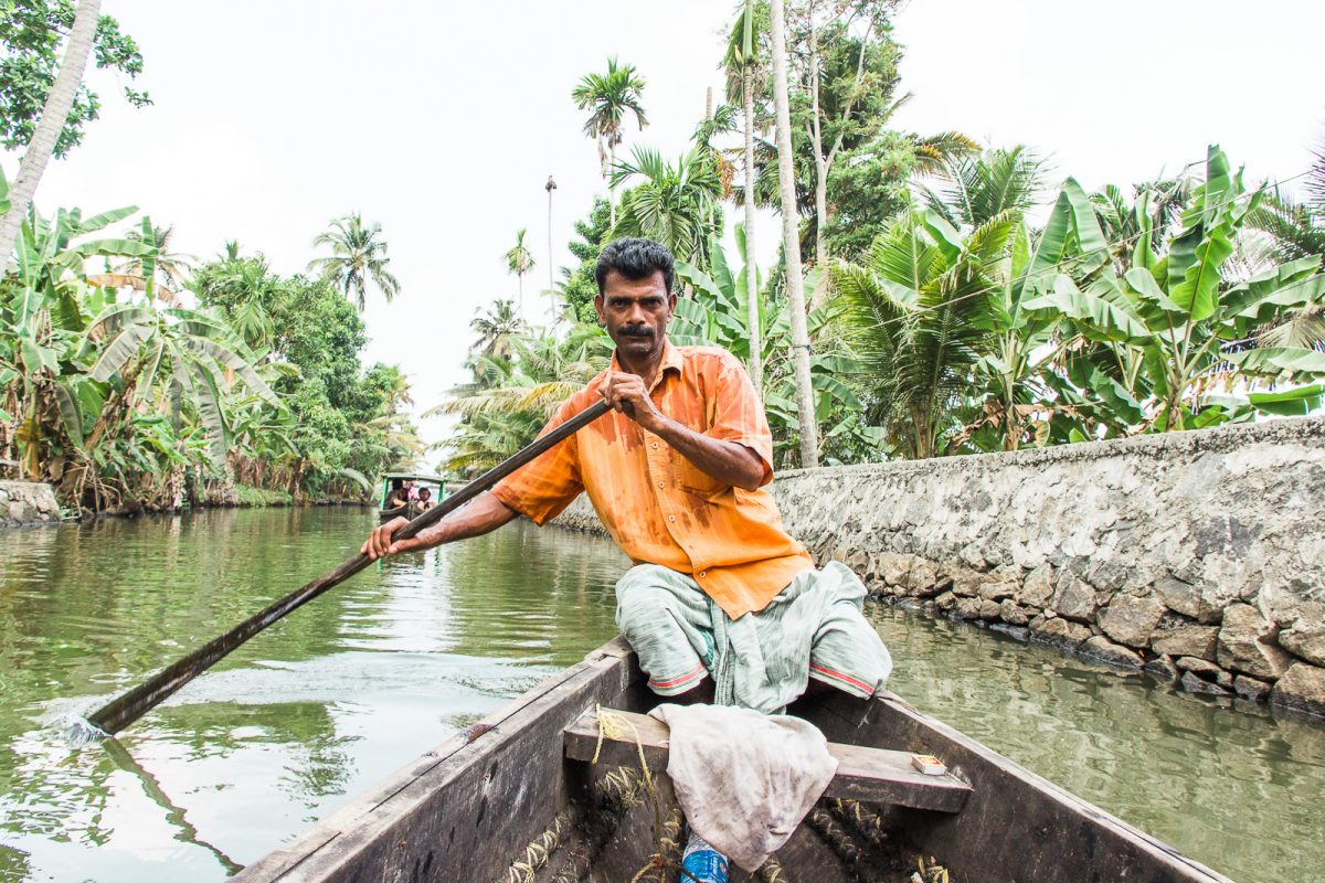 tour guide benny rowing through the backwaters of kerala