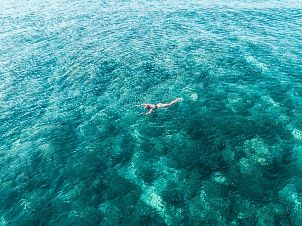 woman snorkeling in Indonesia