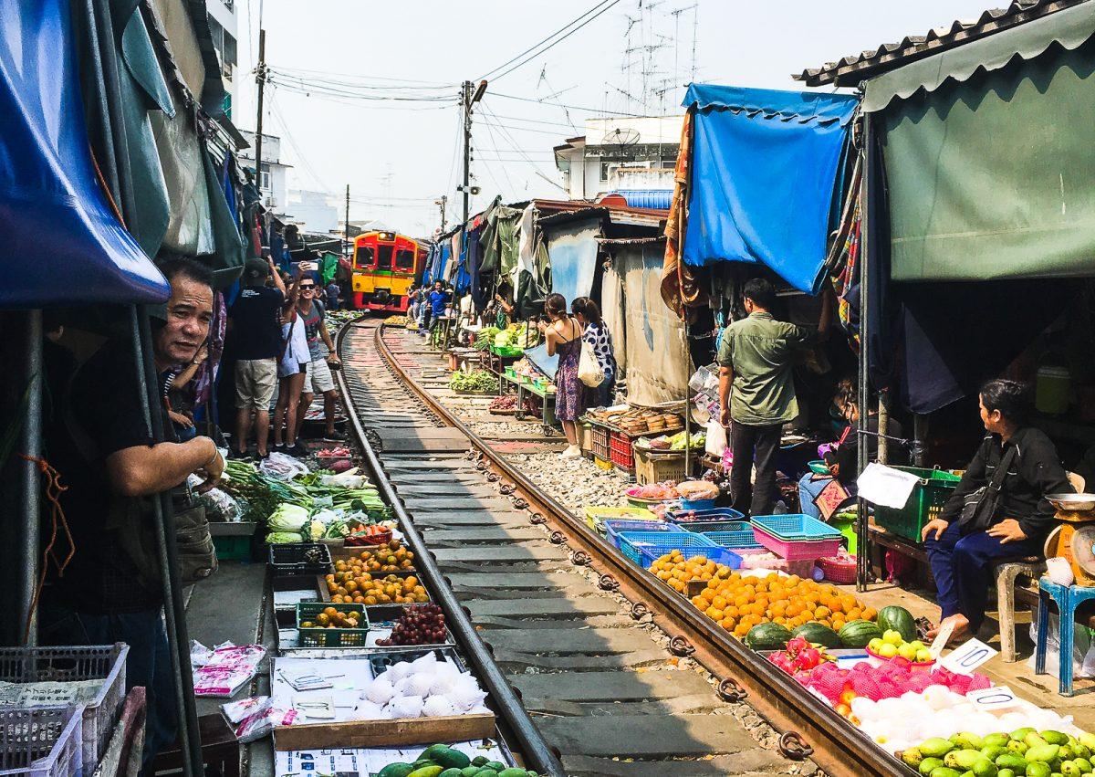 southeast asia bucket list maeklong railway market bangkok thailand