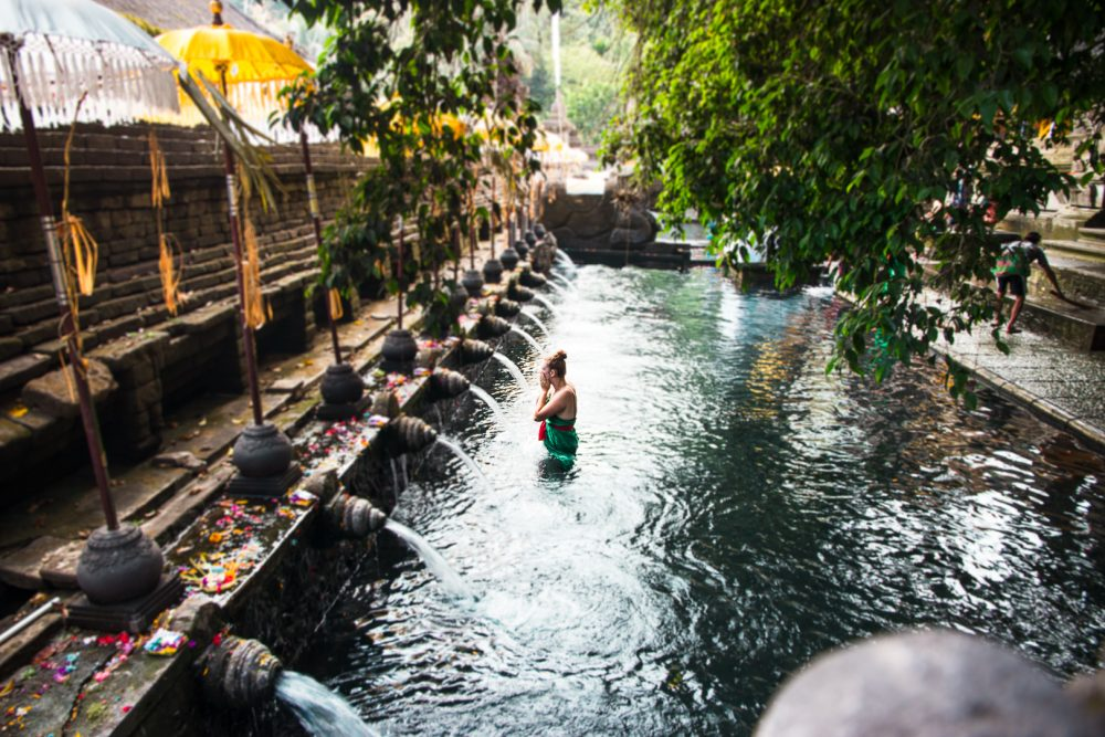 Woman participating in the purification ritual at the Pura Tirta Empul Temple
