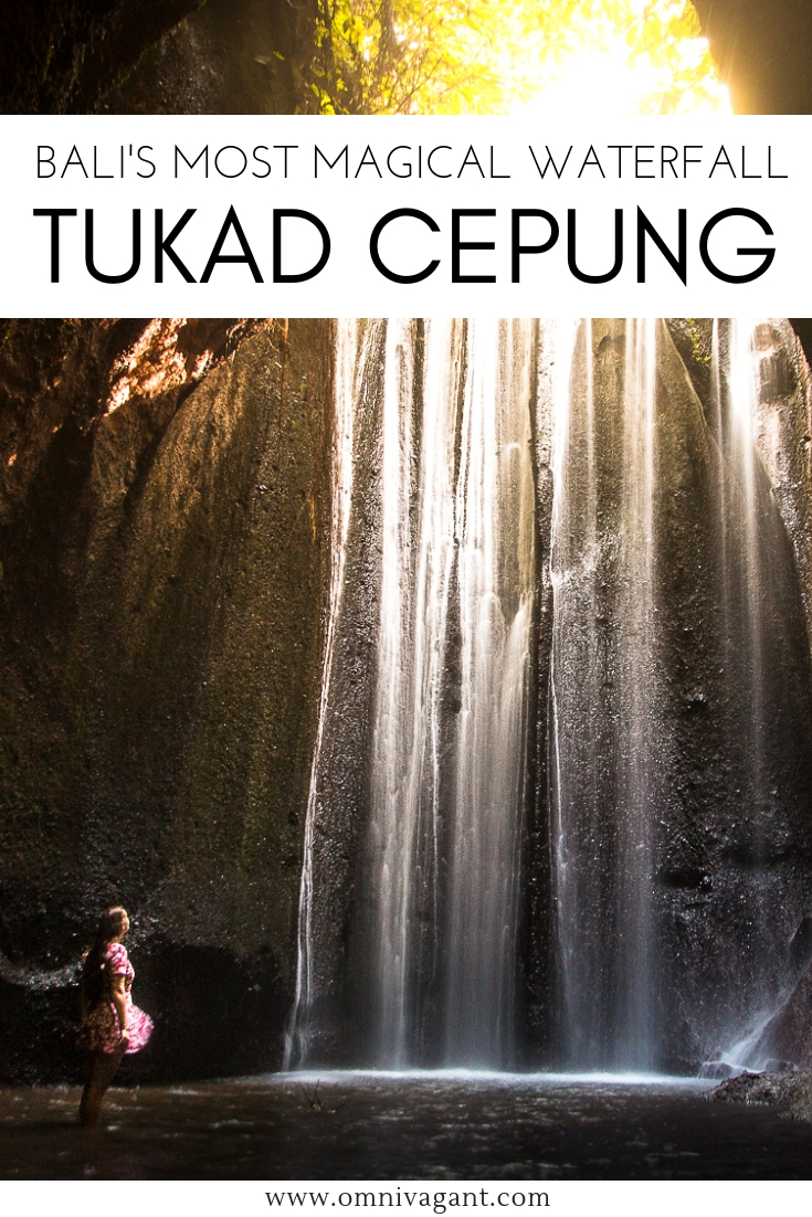 light rays at the tukad cepung waterfall near ubud bali