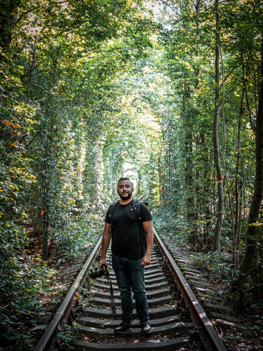 Man standing on the tracks of the tunnel of love