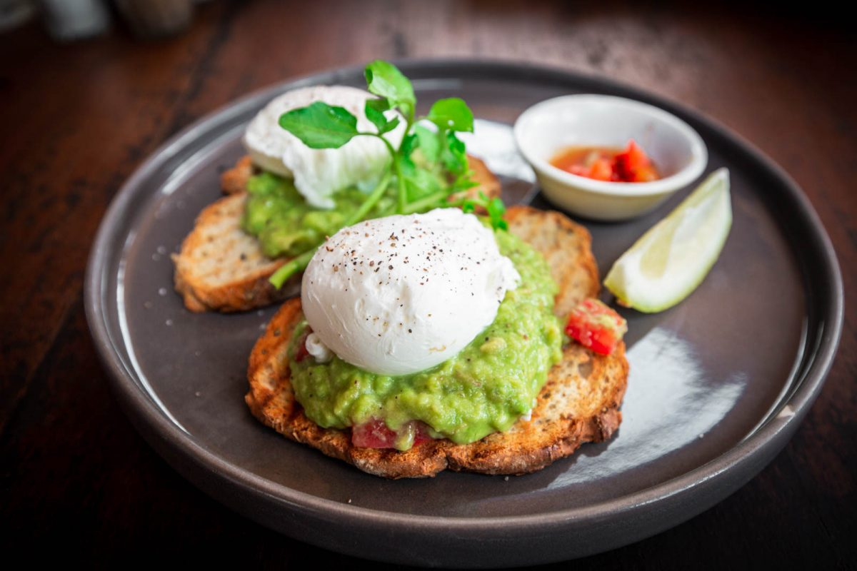 toast with smashes avocado and poached eggs from satusatu a cheap eat in canggu