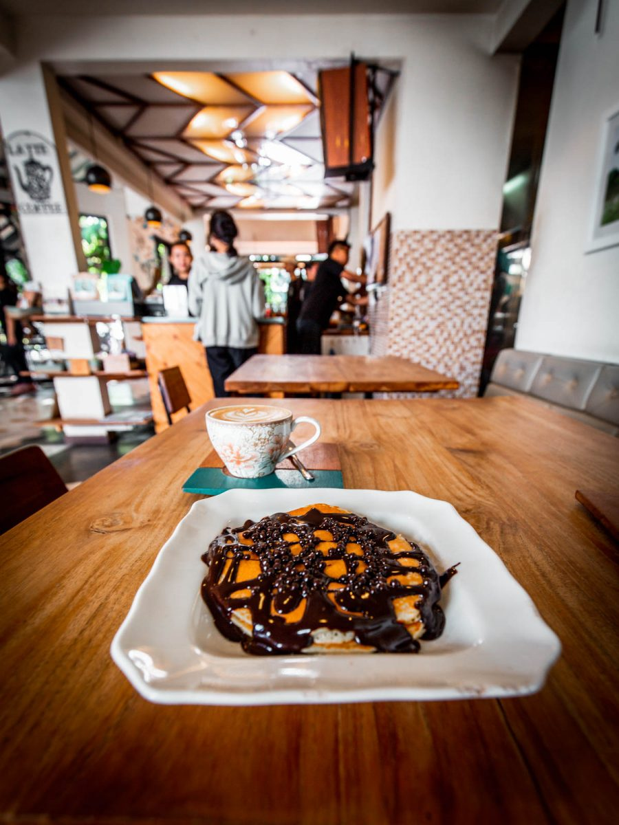 chocolate pancakes and a flat white at a cafe in canggu bali