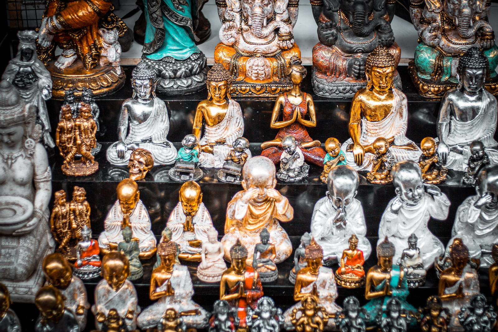 golden and bright coloured statues that are sold as souvenirs at the ubud art market