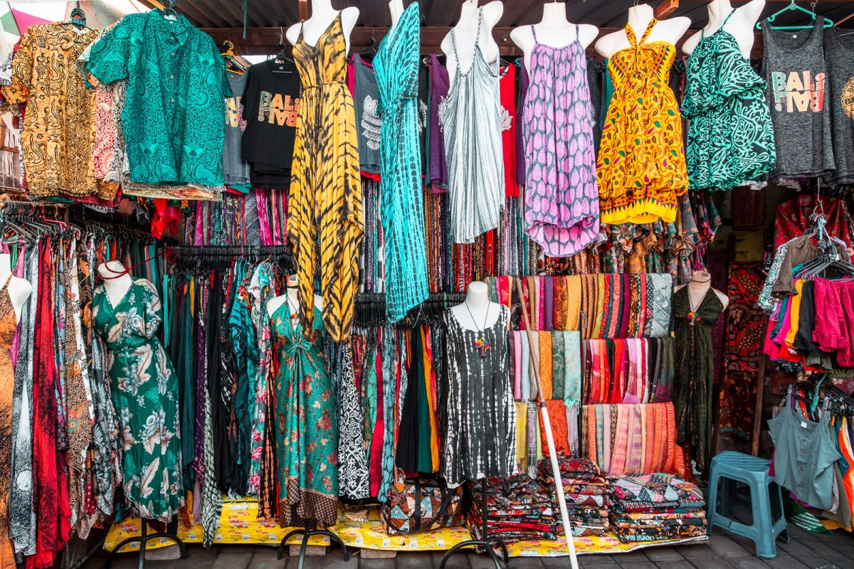 clothing stall selling shirts, shorts, tops, dresses and sarongs at the ubud art market