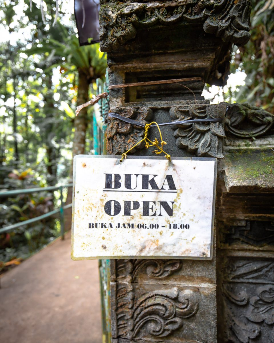 opening hours sign of the pengempu waterfall in bali