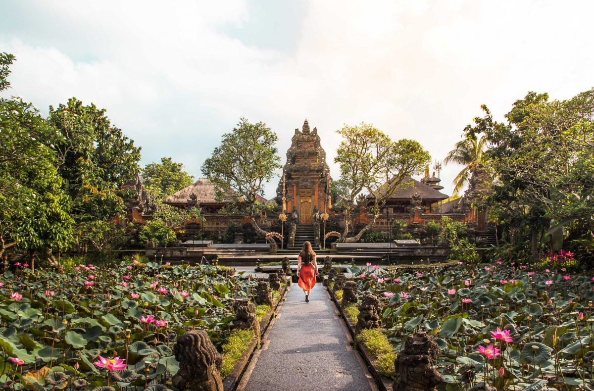 bali packing list - woman walking in front of a temple in bali