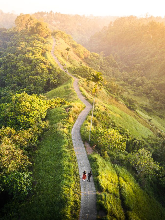 couple standing on the Campuhan Ridge Walk at sunrise in Ubud Bali